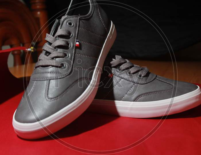 gery shoes with red background