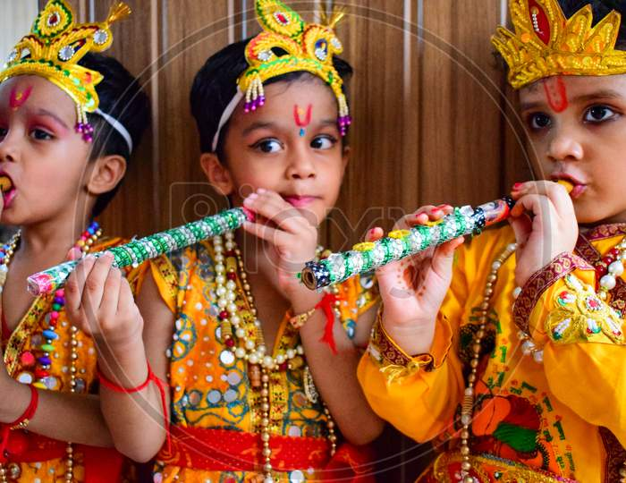 Delhi, India - September 9, 2019 : Cute Indian Kids dressed up as little Lord Krishna Radha on the occasion of Krishna Janmastami Festival in Delhi India