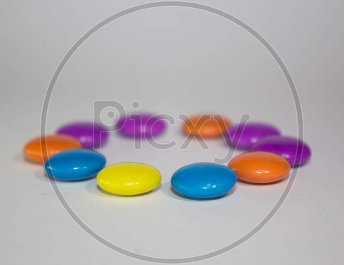 Gems chocolate candy with white background