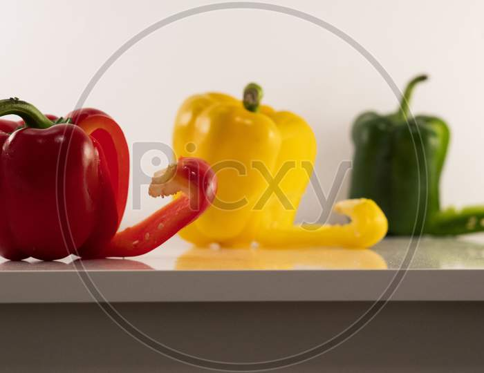 A beautiful image of the yellow, red and green bell peppers (Capsicums).