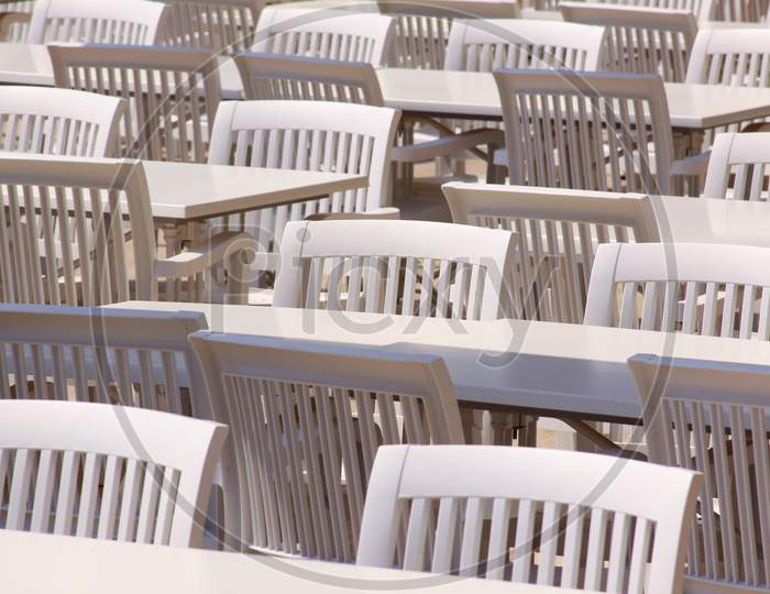White Plastic Tables, Chairs On Restaurant Terrace