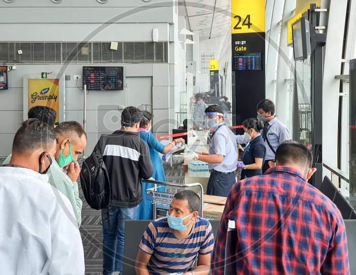 6Th June 2020- Netaji Subhas Chandra Bose International Airport, Calcutta, India-Indigo Airlines Staff Provides Passengers With Personal Protective Equipments Before Boarding Flights