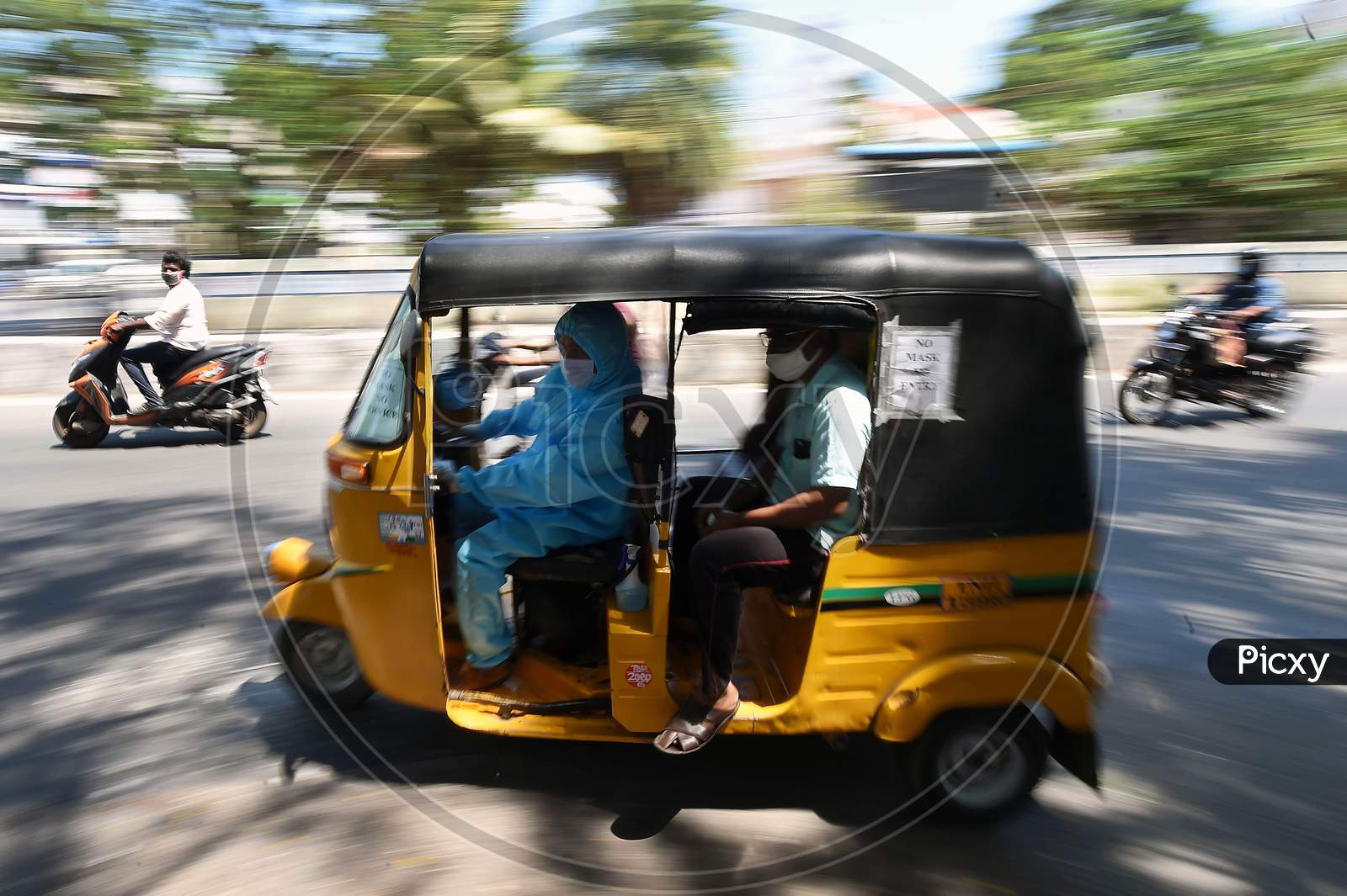 A Auto Rickshaw Driver Wearing Personal Protective Equipment (Ppe) Drives His Customers In Chennai, Tamil Nadu