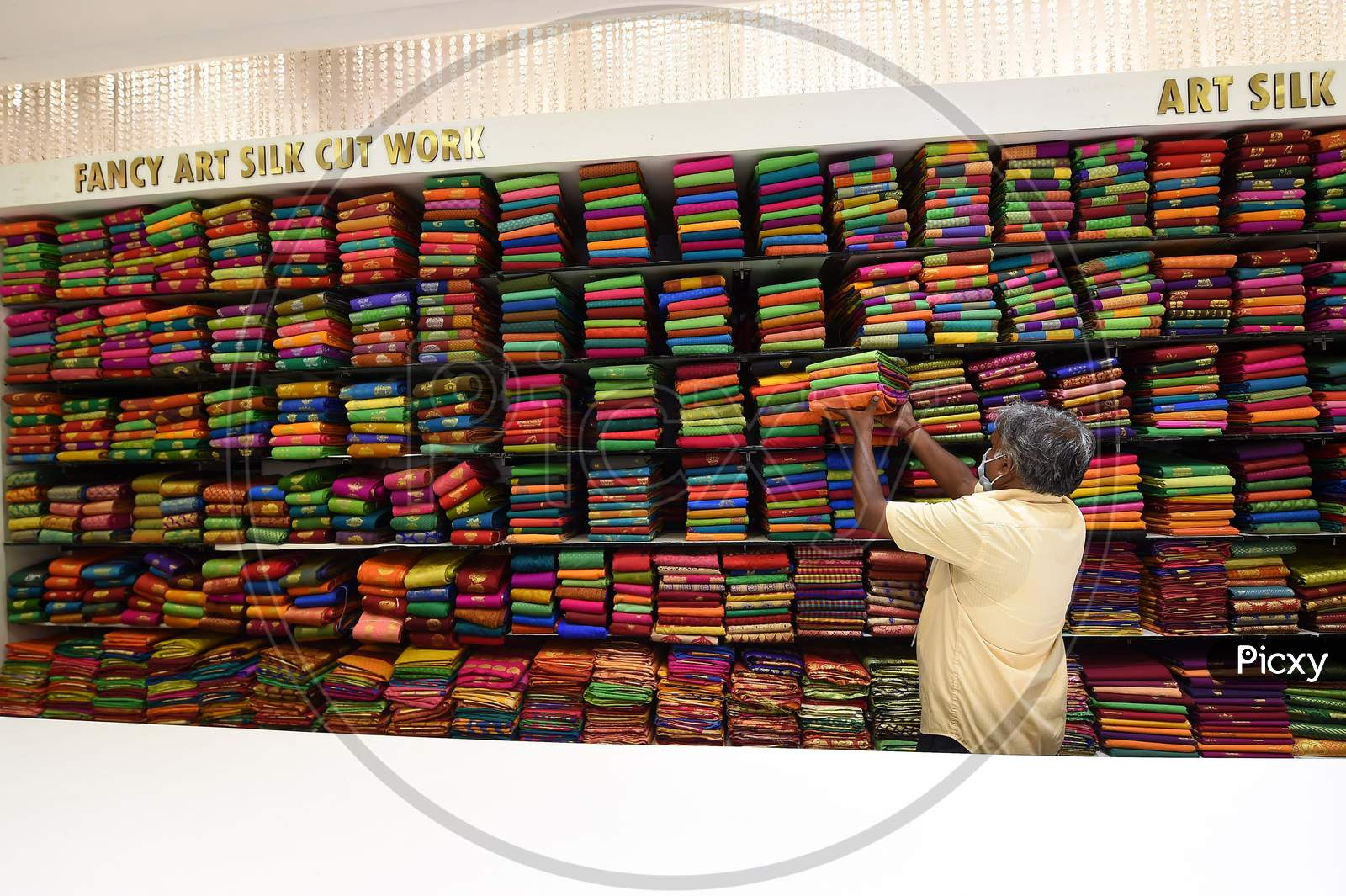 A Salesman Arranges Sarees At A Showroom After Reopening Of Shops Post The Lockdown, In Chennai, Tamil Nadu