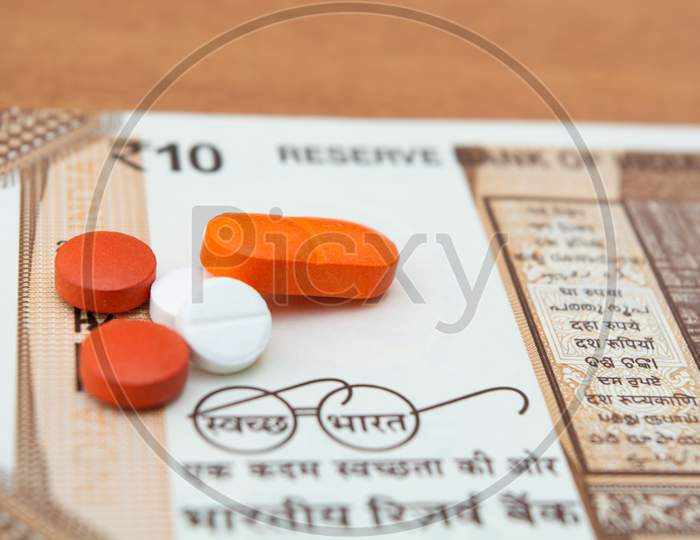 Concept Of The Affordable Medicine In India Due To Generic Drugs On Indian Currency Notes As Background.