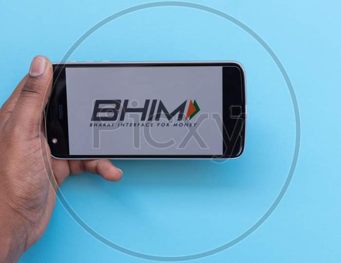 Hands Using Bhim Or Bharat Interface For Money App Is A Digital Wallet By Indian Government Loading On Mobile Phone