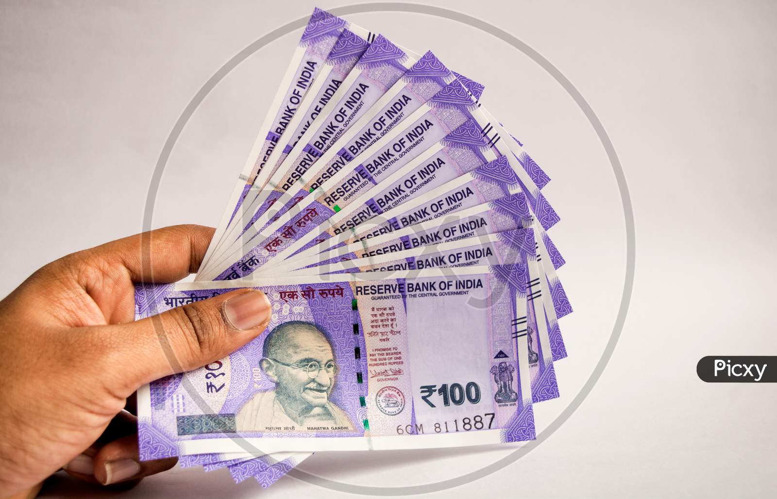 Holding All New 100 Rupees Indian Currencies In Hand On Islolated Background