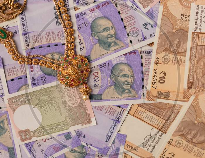 Concept Of Black Money, It Raid, Confiscated Or Unaccounted Money Showing Indian Currency Notes With Jewelry