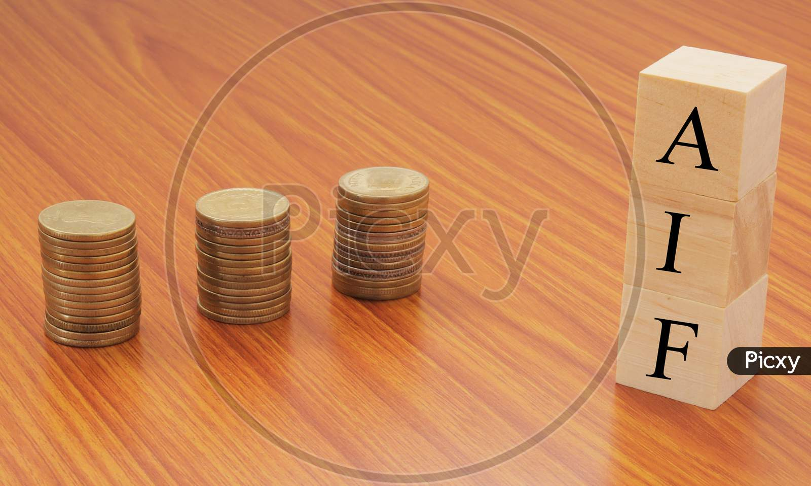 Alternative Investment Funds Or Aif On Wooden Block Letters With Stack Of Currency Coins.