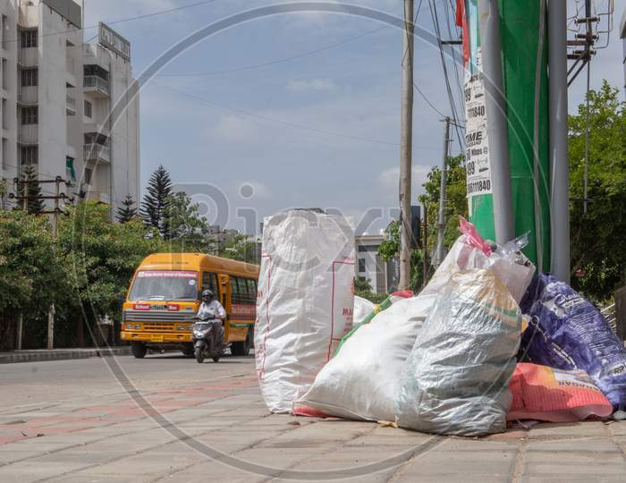 Bengaluru, India June 27, 2019 : Bags Of Rubbish Lie On The Footpath Of The Road. A Bunch Of Trash Thrown On The Road, Environmental Pollution. Garbage Problem At Bengaluru, India