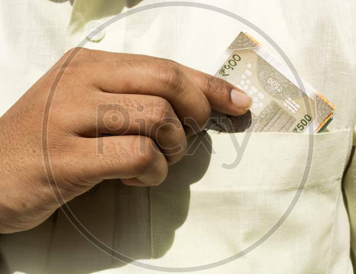 Man Hand Takes A New 500 Indian Currency Note Out Of His Pocket Close Up