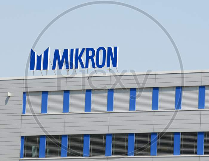 Logo Of Mikron Group In Agno, Switzerland
