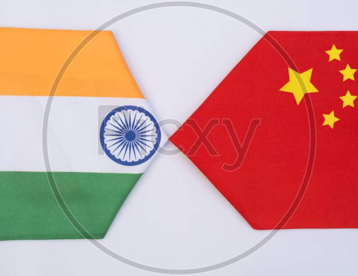 Direction Of China And India Flags On Isolated Background