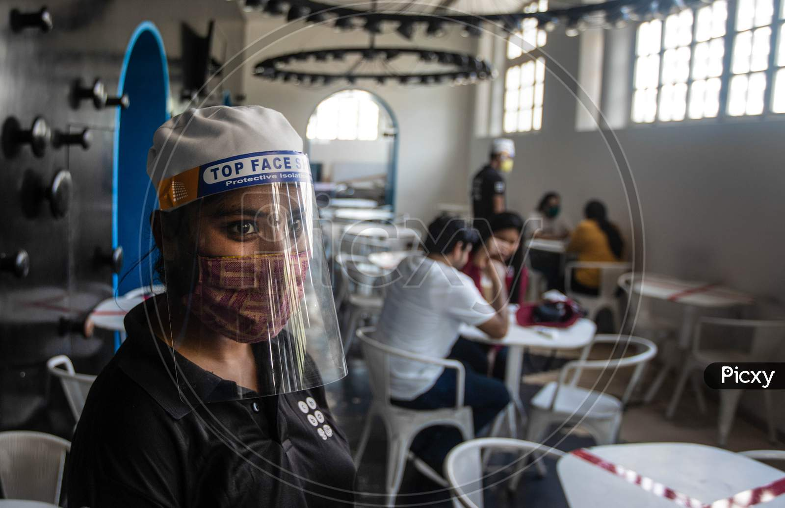 People Wearing Masks and face shields Are Seen At The Restaurant As India Eases Lockdown Restrictions That Were Imposed To Slow The Spread Of The Coronavirus Disease (Covid-19), In New Delhi, India, June 8, 2020.