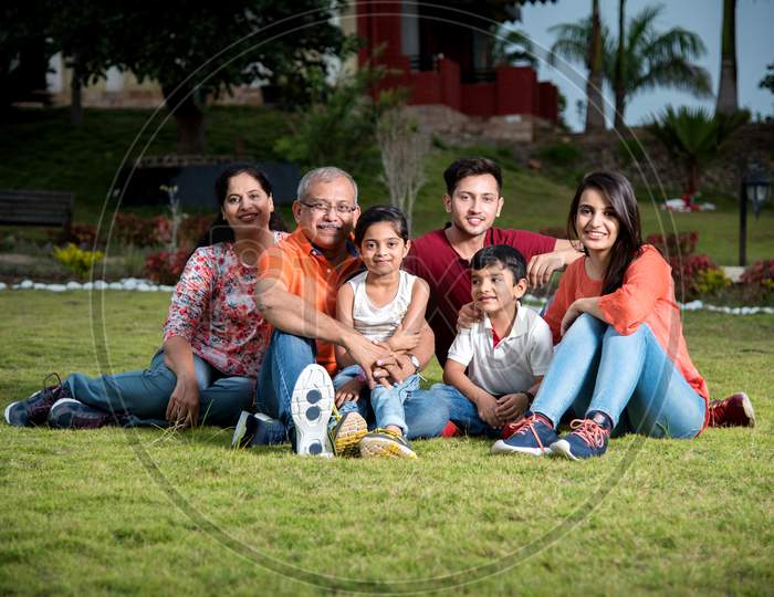 Indian family sitting outdoor