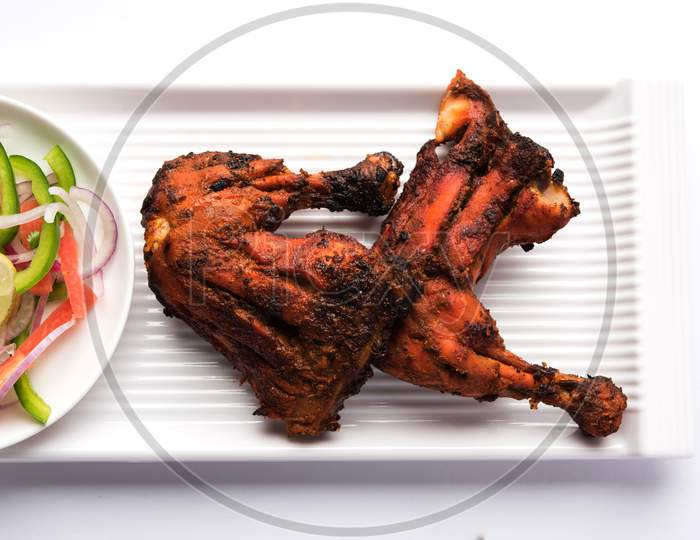 Tandoori chicken or barbecue grilled chicken legs