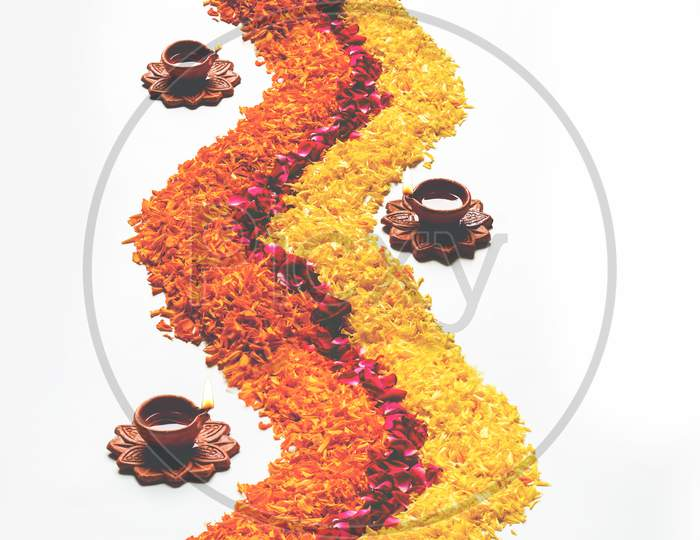 Flower Rangoli Strip with Diya