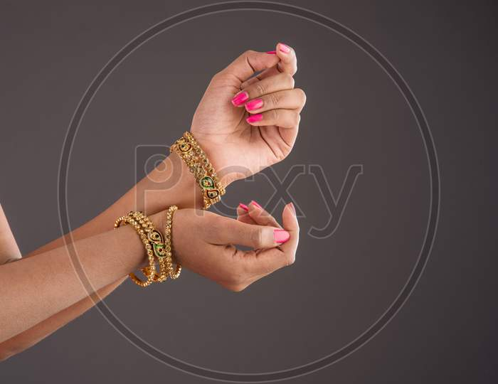 Closeup of girl wearing traditional designer gold bangles/bracelets