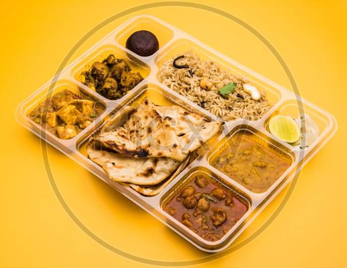 Indian vegetarian thali or food platter for parcel