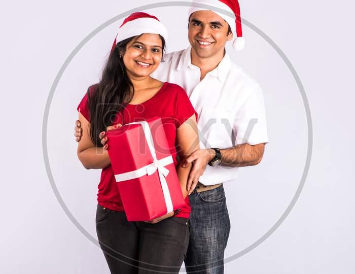Indian young couple celebrating Christmas / X-mas