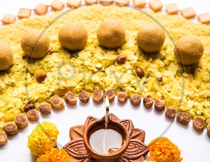 Design strip using diwali diya and food