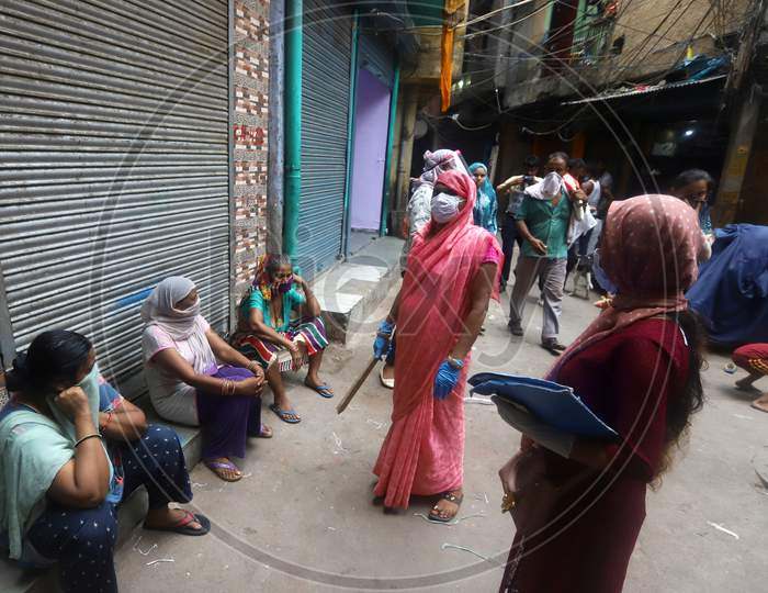 Health workers educating people on the importance of maintaining social distancing in a containment zone in Nabi Karim Area, New Delhi on July 06, 2020