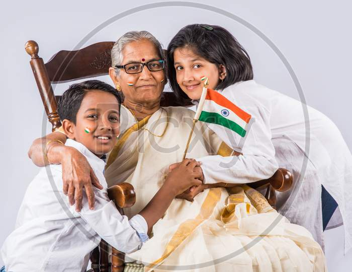 Indian family holding national flag on Independence day or Republic day