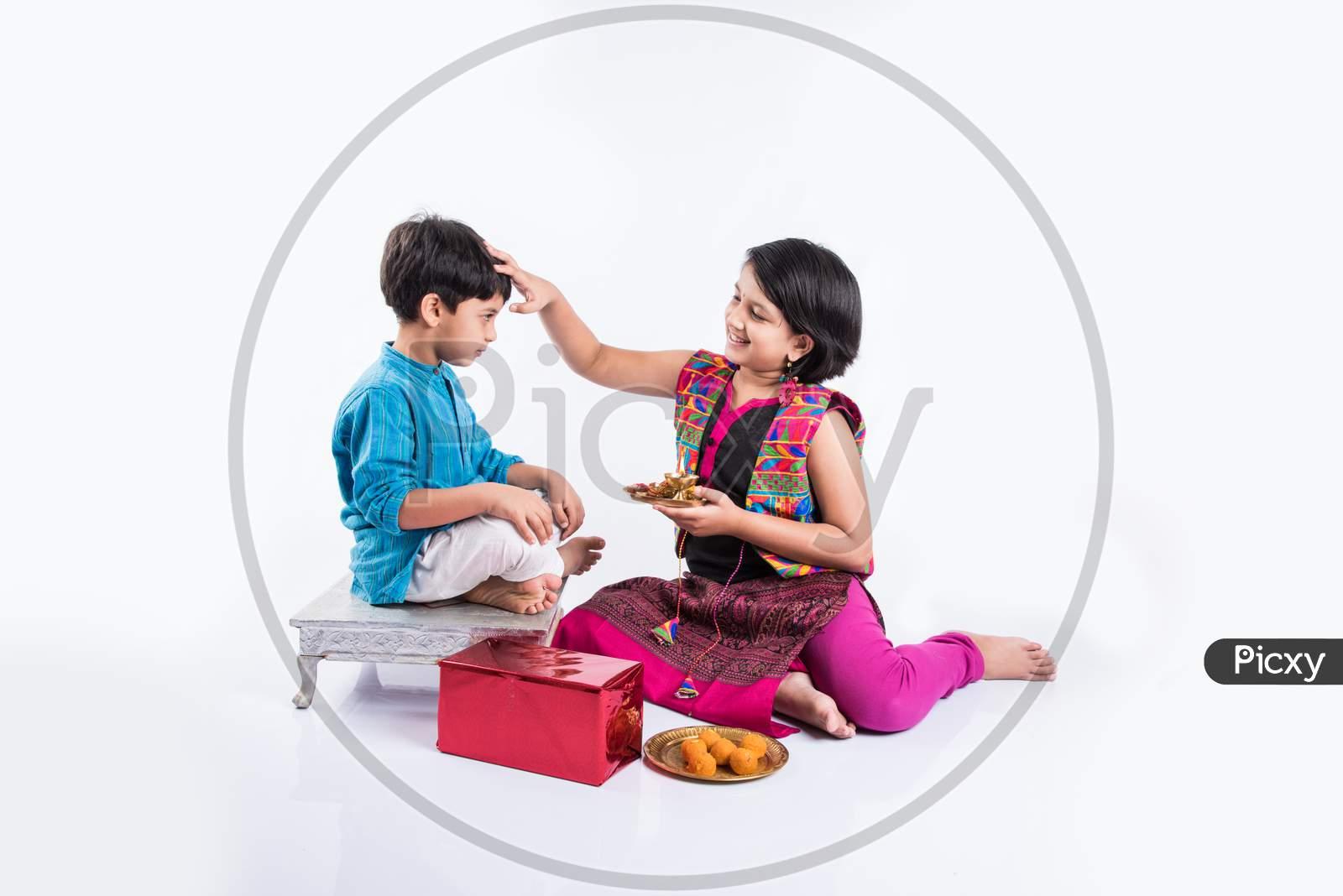 small brother and sister together Rakshabandhan Or Rakhi festival