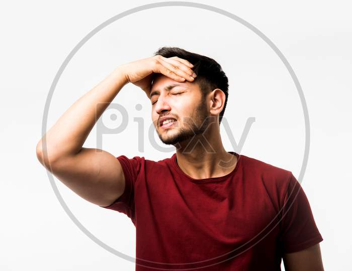 man suffering from head ache
