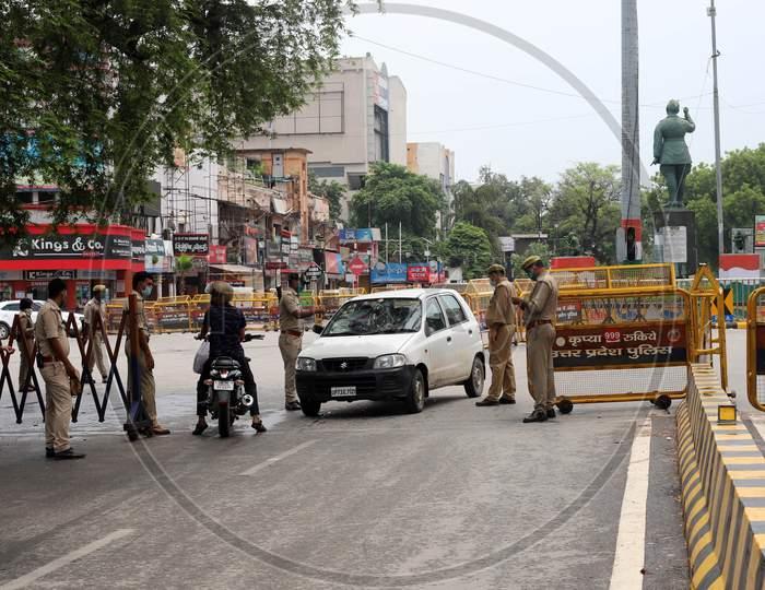 Police officials inspect vehicles during the lockdown in Prayagraj, Uttar Pradesh on July 12, 2020