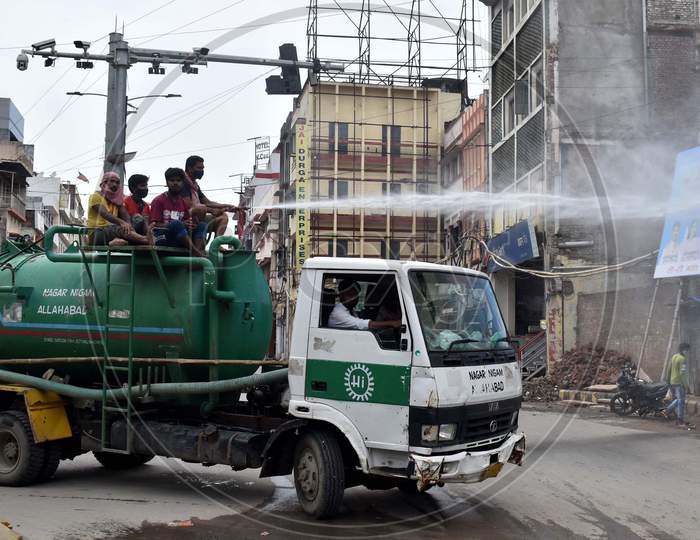 Municipal workers spray disinfectants to sanitize the market during the lockdown to control the spread of Coronavirus in Prayagraj On July 12, 2020