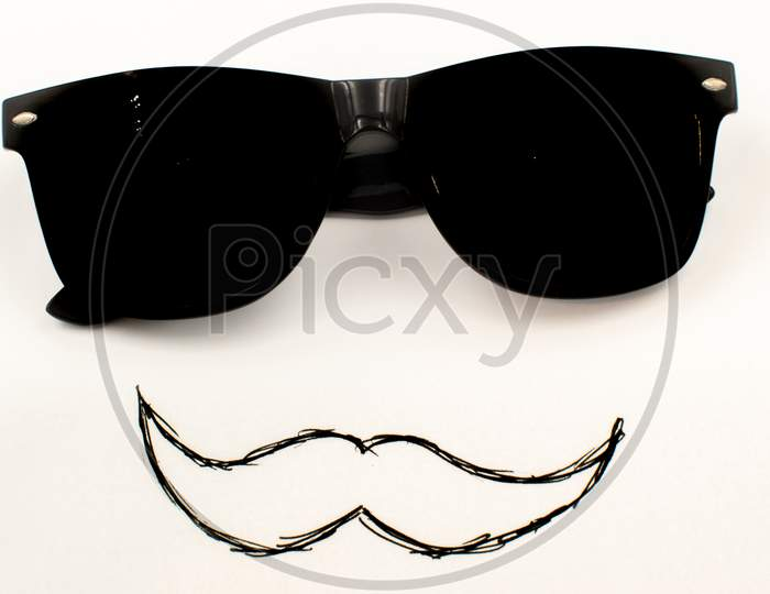Black Sunglasses With A Hand Drawn Moustache Isolated On A White Background