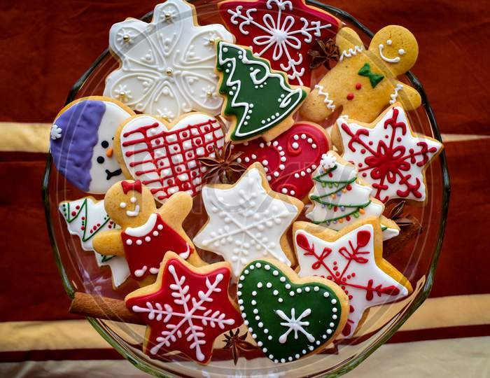 Traditionally Decorated Christmas Gingerbread Cookies On A Blass Bowl
