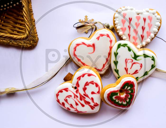 Traditionally Decorated Heart Shaped Christmas Gingerbread Cookies Background
