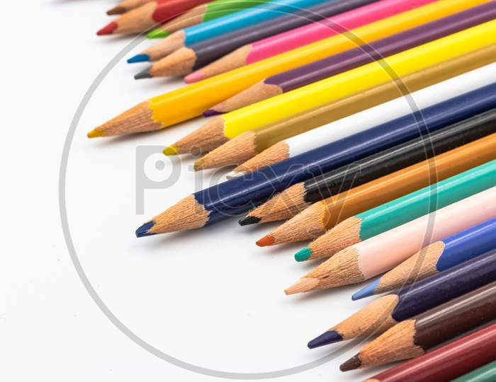Color Pencils Isolated On White Background In A Row