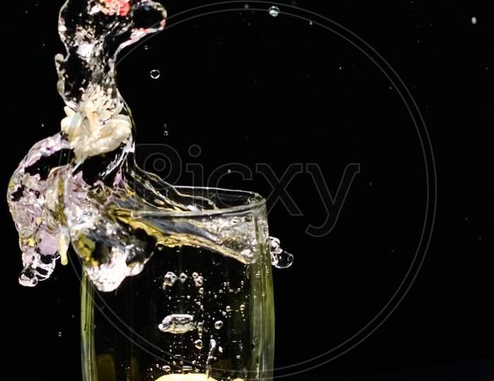 Beautiful Closeup Photograph Of Water Splash With Black Background,