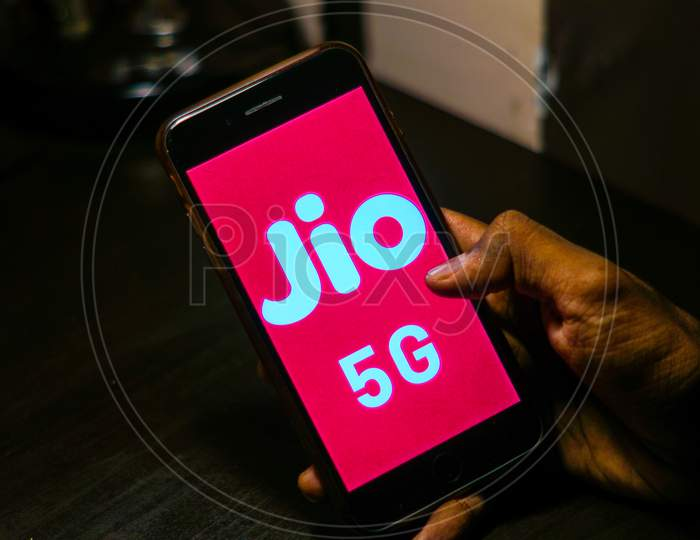 Close up shot of a Person using a Smartphone or Mobile Phone with Jio 5g on Screen