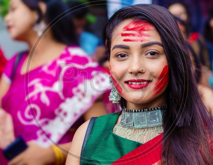 Holi and Durga puja Festival in India. Portrait of an unidentified Bengali woman playing with vermilion or colors on vijay dashami at the Durga puja festival in Kolkata on 8th October 2019.