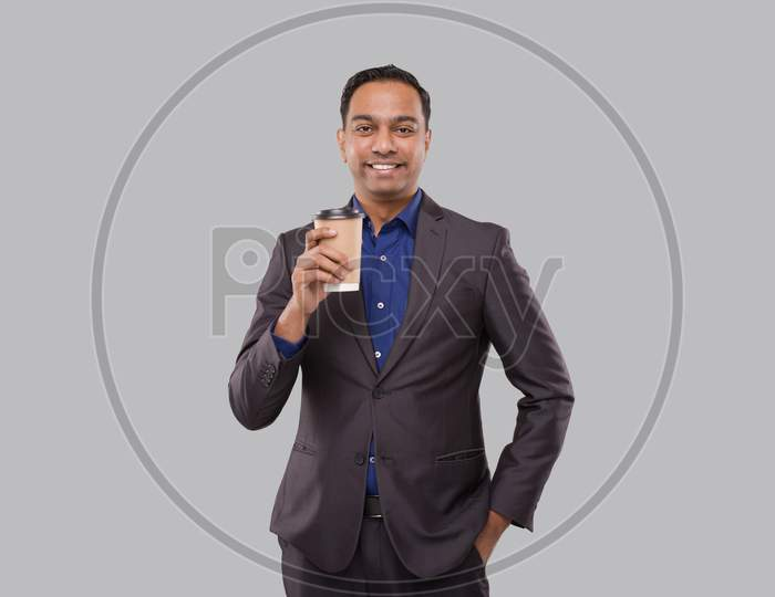 Businessman Holding Coffee To Go Cup Isolated. Indian Business Man With Coffee Take Away Cup In Hands