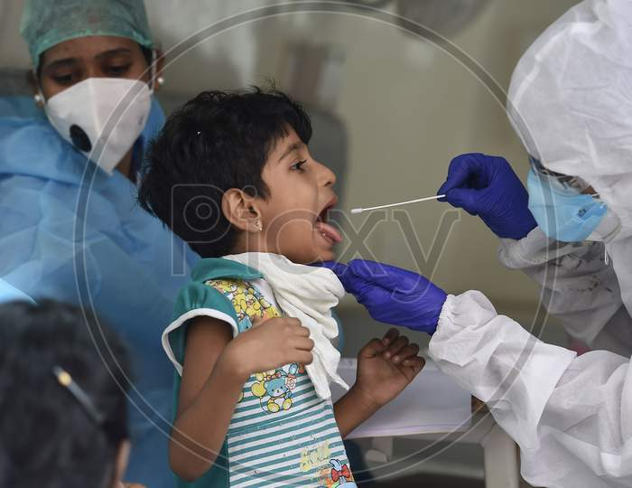 A health worker collects swab samples for Covid-19 testing in Chennai