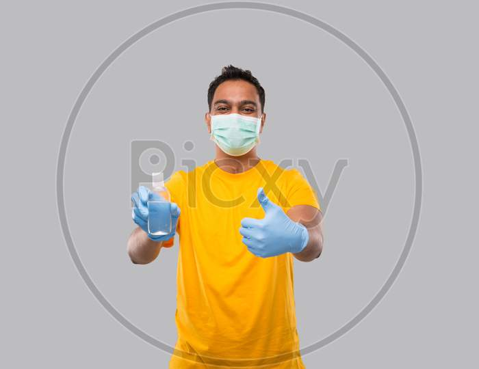 Indian Man Showing Hands Sanitizer And Thumb Up Wearing Medical Mask And Gloves Isolated. Indian Man Holding Hand Antiseptic