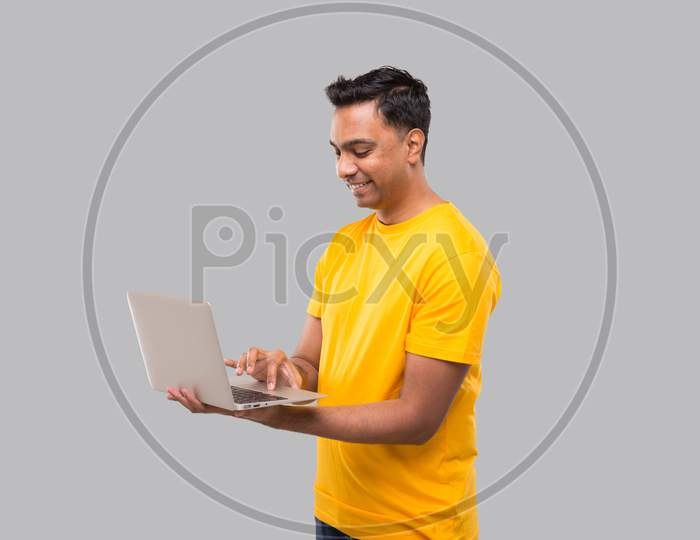 Indian Man Using Laptop. Home Orders, Quarantine Delivery, Shopping Online, Freelance Worker Concept.