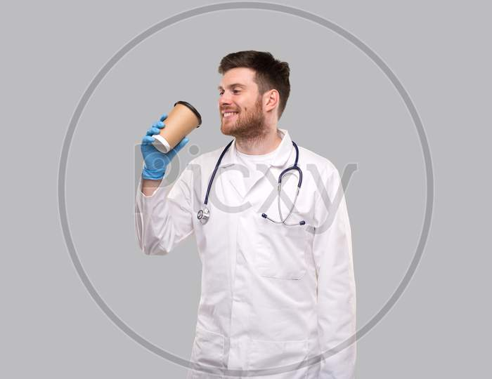 Doctor Drinking Coffee From To Go Cup Smiling Isolated