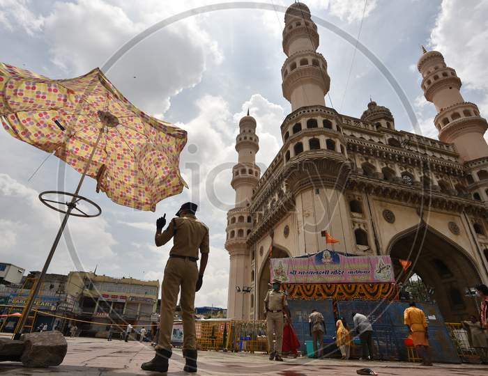 A Police Constable stands guard at the Closed Bhagyalakshmi Temple at Charminar  amid raising concerns of Coronavirus on July 19, 2020, Hyderabad, Bonalu 2020.