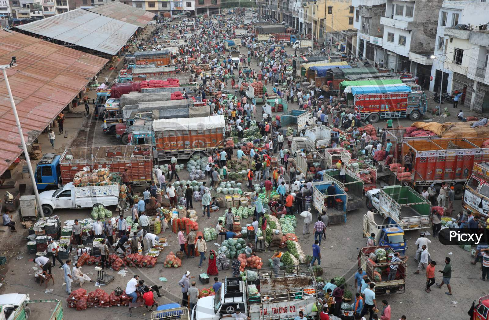 A view of people at a wholesale vegetable market seen defying social distancing guidelines, during Unlock 2.0, in Jammu