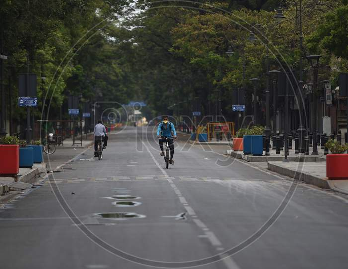 A man pedals his bicycle on a deserted road after the Government imposed a total lockdown in Chennai