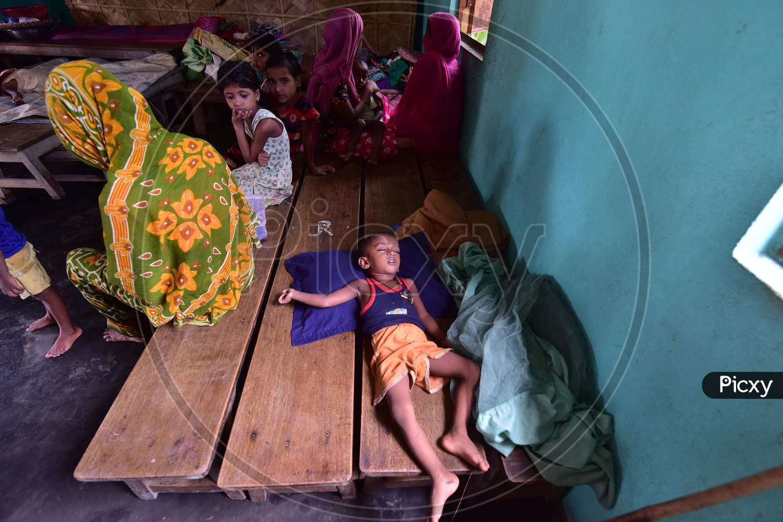 A child sleeps inside a flood relief camp at a school in Madhabpara village in Nagaon, Assam on July 22, 2020