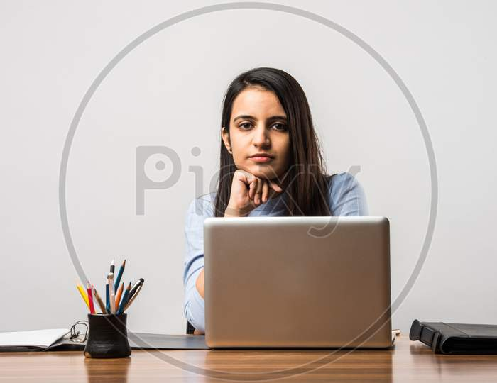 Indian Asian Pretty Girl Working On Laptop At Desk