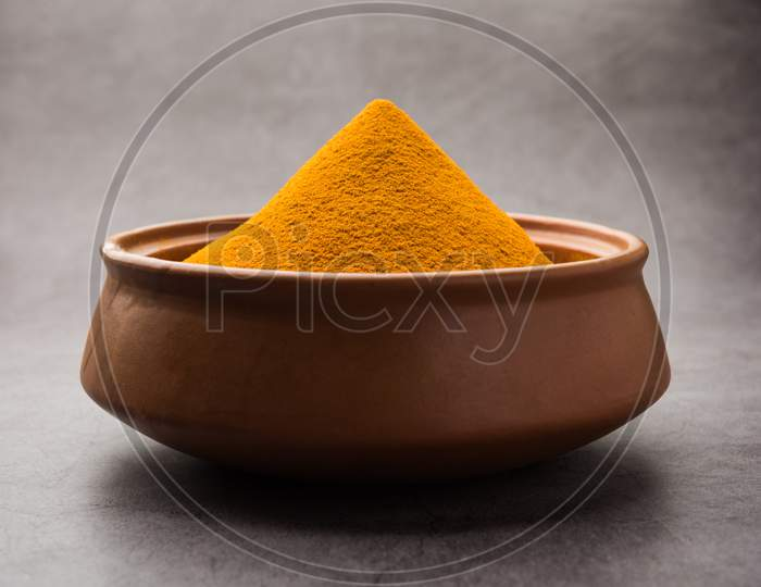 Organic Haldi Or Turmeric Powder Spice Pile In A Bowl With Whole, Selective Focus