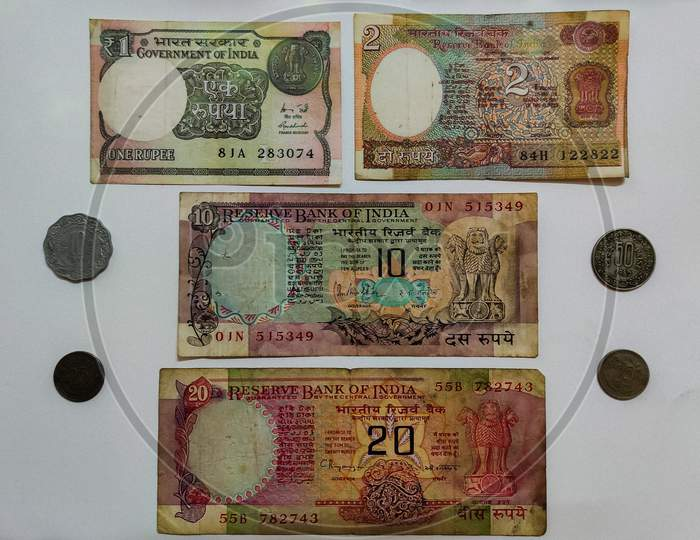 Collection of old currency notes and coins of India.
